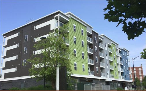 dark gray and green condominium white windows
